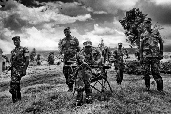 Africa, R.D.C.- North Kivu, Rutshuru. Brigadier General Sultani Makenga (seated) of the newly formed Congolese Revolutionary is seen in Rumangabo military camp (Bunagana), Democratic Republic of Congo. The M23 Movement, the newly formed political wing of former M23 rebels, has formed a semi autonomous administration structure in areas under their control in north Kivu province in the DRC. 15th October 2012. ©Marco Gualazzini/Getty Images Grants for Editorial Photography Recipient 2013.